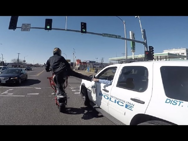 Cop Fist Bumps Biker Doing Wheelie Part 1