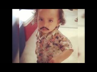 This little lad nails his Pablo Escobar costume