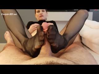 Felice giving footjob in black pantyhose