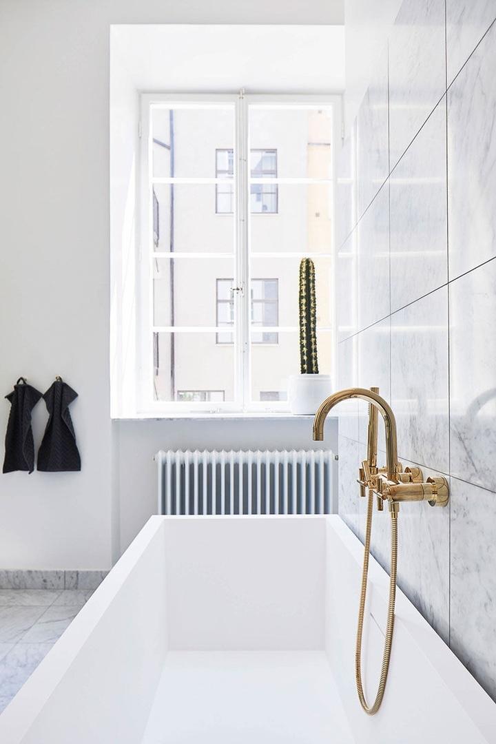 Современный интерьер с минималистичной кухней в Стокгольме