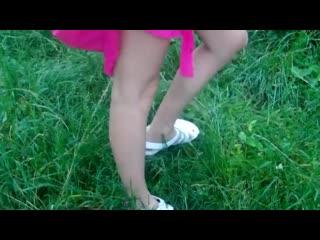 Girl pees outside on log
