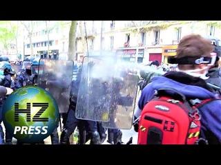 Un individu gaze des policiers lors du défilé du 1er mai à Paris -